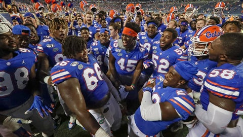 <p>               Florida players celebrate after defeating Miami 24-20 in an NCAA college football game Saturday, Aug. 24, 2019, in Orlando, Fla. (AP Photo/John Raoux)             </p>