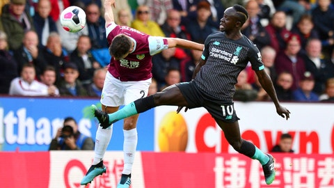 <p>               Burnley's Matthew Lowton, left, and Liverpool's Sadio Mane battle for the ball during the English Premier League soccer match at Turf Moor, Burnley, England, Saturday Aug. 31, 2019. (Anthony Devlin/PA via AP)             </p>