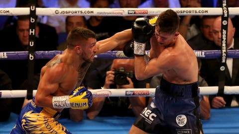 <p>               Vasiliy Lomachenko, left, and Luke Campbell fight during the WBC, WBO, WBA & Ring Magazine World Lightweight Championship contest at the O2 Arena, London on Saturday, Aug. 31, 2019. (Steven Paston/PA via AP)             </p>