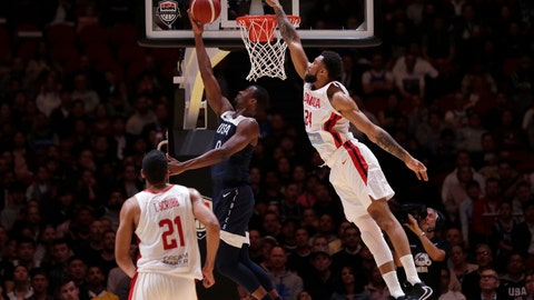 <p>               Canada's Khem Birch, right, attempts to defend a layup by United States' Harrison Barnes during their exhibition basketball game in Sydney, Australia, Monday, Aug. 26, 2019. (AP Photo/Rick Rycroft)             </p>