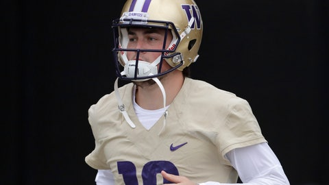 <p>               FILE - In this April 3, 2019, file photo, Washington quarterback Jacob Eason jogs to the field for NCAA college football practice in Seattle. Eason replaces Jake Browning, who threw for 3,192 yards with 16 touchdowns last season, leading the Huskies to a 10-4 record and the Pac-12 championship. Browning now plays for the NFL's Minnesota Vikings.(AP Photo/Ted S. Warren, File)             </p>