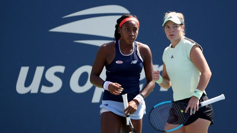 <p>               Coco Gauff, left, and Catherine McNally, both of the United States, talk during a first round doubles match against Julia Goerges, of Germany, and Katerina Siniakova, of the Czech Republic, at the US Open tennis championships Friday, Aug. 30, 2019, in New York. (AP Photo/Kevin Hagen)             </p>
