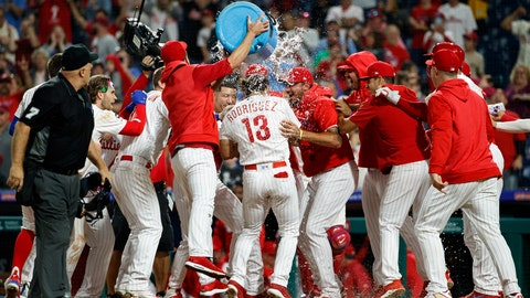 <p>               Philadelphia Phillies' Sean Rodriguez (13) celebrates with teammates after hitting a winning home run off Pittsburgh Pirates relief pitcher Michael Feliz during the 11th inning of a baseball game, Monday, Aug. 26, 2019, in Philadelphia. (AP Photo/Matt Slocum)             </p>