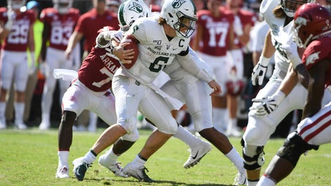 <p>               Portland State quarterback Davis Alexander tries to get away from Arkansas defender Joe Foucha as he scrambles out of the pocket in the first half of an NCAA college football game, Saturday, Aug. 31, 2019 in Fayetteville, Ark. (AP Photo/Michael Woods)             </p>