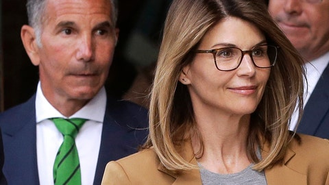 <p>               FILE - In this April 3, 2019, file photo, actress Lori Loughlin, front, and husband, clothing designer Mossimo Giannulli, left, leave federal court in Boston after facing charges in a nationwide college admissions bribery scandal. Loughlin and Giannulli are scheduled for a hearing in the bribery scam case on Tuesday, Aug. 27 in Boston. (AP Photo/Steven Senne, File)             </p>