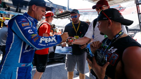 <p>               Driver Clint Bowyer signs autographs before practice for a NASCAR Cup Series auto race, Friday, Aug. 16, 2019, in Bristol, Tenn. (AP Photo/Wade Payne)             </p>
