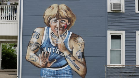 """<p>               A mural of former NBA star Larry Bird is seen on the side of a multi-family residence in Fountain Square, Wednesday, Aug. 21, 2019, in Indianapolis. Larry Bird likes the mural but not the tatts. Bird's attorney, Gary Sallee, says the former Indiana Pacers executive """"needs to protect"""" his brand and """"doesn't want to be seen as a tattooed guy."""" Artist Jules Muck says she was just trying to be funny. The mural is a replica of Bird's appearance on a 1977 Sports Illustrated cover when he played college ball for Indiana State. (AP Photo/Darron Cummings)             </p>"""