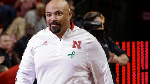 <p>               FILE - In this Jan. 27, 2018, file photo, Jovan Dewitt, Nebraska football outside linebackers and special teams coach, is introduced to fans at halftime of an NCAA college basketball game against Iowa, in Lincoln, Neb. Dewitt's happy place is on the practice field, and he's never appreciated being there as much as he does now. Dewitt is back at his job as Nebraska's outside linebackers coach and special teams coordinator following intense treatments for throat cancer that caused him to lost 102 pounds and zapped most of his energy. (AP Photo/Nati Harnik, File)             </p>