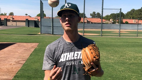 <p>               In this Friday, Aug. 23, 2019, photo, Oakland Athletics rookie pitcher Nathan Patterson tosses a baseball, in Mesa, Ariz. Patterson earned a contract after hitting 96 mph on the radar gun at a fan pitching challenge at Colorado's Coors Field. He made his last appearance for the A's in rookie league on Aug. 25, allowing a hit in 2 2/3 innings with two strikeouts against the Cleveland Indians. (AP Photo/John Marshall)             </p>