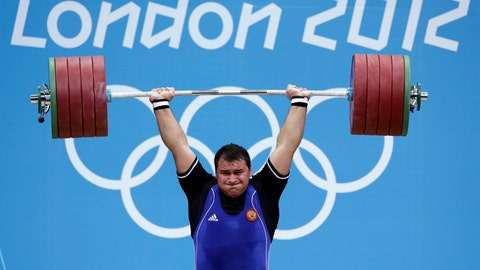 <p>               FILE - In this file photo dated Tuesday, Aug. 7, 2012, Ruslan Albegov of Russia competes during men's over 105-kg weightlifting competition at the 2012 Summer Olympics, in London.  The International Weightlifting Federation said Tuesday Aug. 13, 2019, evidence against the five lifters, including Olympic bronze medalist Ruslan Albegov, comes from new investigations by the World Anti-Doping Agency into widespread drug use in Russian sports, which could herald a new wave of cases across a range of sports. (AP Photo/Hassan Ammar, FILE)             </p>