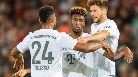 <p>               Munich's Kingsley Coman, center, celebrates with team mates Corentin Tolisso, left, and Leon Goretzka, right, after he scores his side second goal during the German soccer cup, DFB Pokal, first Round match between FC Energie Cottbus and FC Bayern Munich in Cottbus, Germany, Monday, Aug. 12, 2019. Left stand Munich's Robert Lewandowski. (Robert Michael/dpa via AP)             </p>