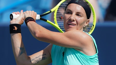 <p>               Svetlana Kuznetsova, of Russia, returns to Ashleigh Barty, of Australia, during the Western & Southern Open tennis tournament, Saturday, Aug. 17, 2019, in Mason, Ohio. (AP Photo/John Minchillo)             </p>