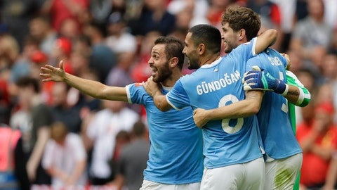 <p>               Manchester City's İlkay Gündoğan celebrates with team mates after the penalty shootout during the English Community Shield soccer match between Liverpool and Manchester City at Wembley stadium in London, Sunday, Aug. 4, 2019. (AP Photo/Kirsty Wigglesworth)             </p>