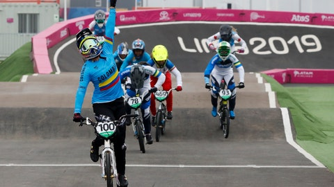 <p>               Mariana Pajon of Colombia celebrates winning the gold medal in the women's cycling BMX final at the Pan American Games in Lima, Peru, Friday, Aug. 9, 2019. (AP Photo/Fernando Llano)             </p>