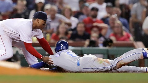 <p>               Boston Red Sox third baseman Rafael Devers, left, tags out Kansas City Royals' Billy Hamilton, right, who tried to advance to third on a flyout during the fourth inning of a baseball game at Fenway Park in Boston, Wednesday, Aug. 7, 2019. (AP Photo/Charles Krupa)             </p>