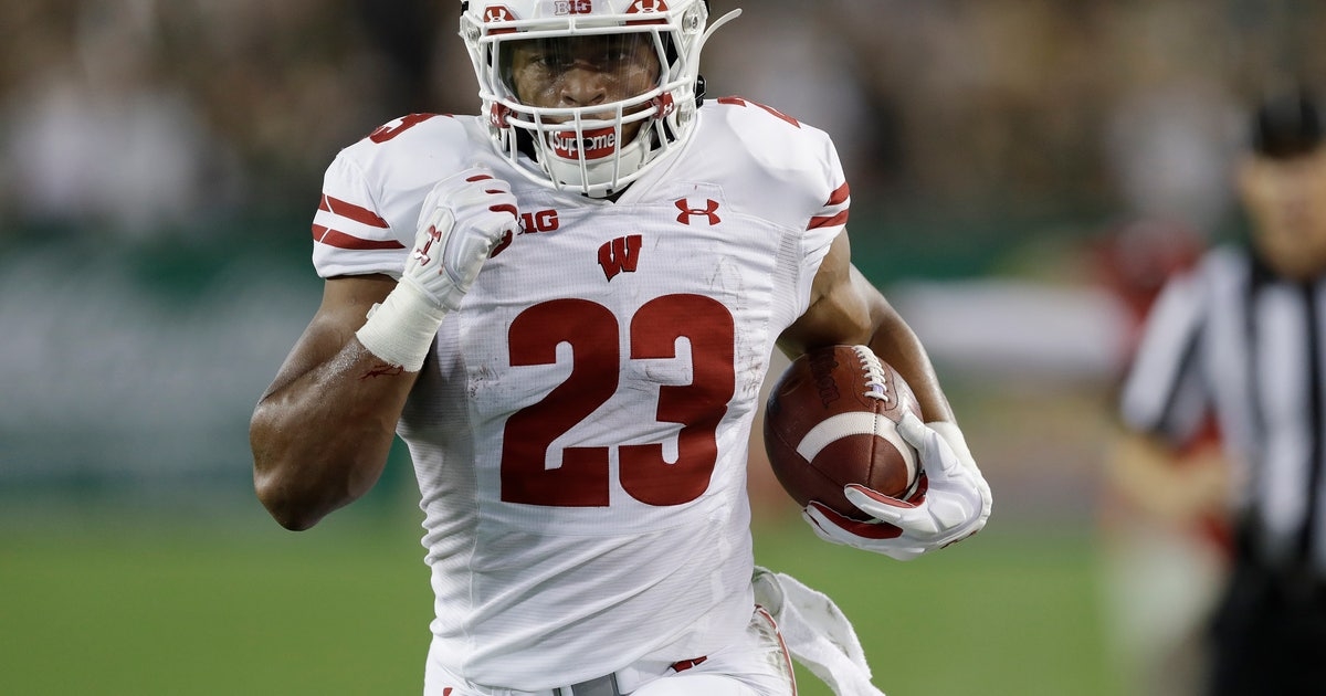 Taylor scores 4 TDs, No. 19 Wisconsin routs USF 49-0 | FOX Sports