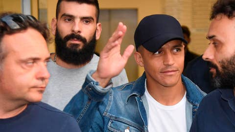 <p>               Alexis Sanchez, second from right, waves to fans upon his arrival at the Coni (Italian Olympic Committee) office for medical checks, in Milan, Italy, Wednesday, Aug. 28, 2019. Sanchez will leave Manchester united on a loan deal with the Italian Serie A soccer team, Inter Milan, Italian news agency ANSA said. (Daniel Dal Zennaro/ANSA via AP)             </p>
