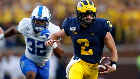 <p>               Michigan quarterback Shea Patterson (2) runs past Middle Tennessee linebacker Chris Melton (32) in the first half of an NCAA college football game in Ann Arbor, Mich., Saturday, Aug. 31, 2019. (AP Photo/Paul Sancya)             </p>