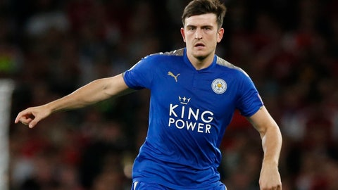 <p>               FILE  - In this Friday, Aug. 11, 2017 file photo, Leicester City's Harry Maguire looks to pass the ball during their English Premier League soccer match between Arsenal and Leicester City at the Emirates stadium in London. A person with knowledge of the deal says Manchester United is set to break the world transfer record for a defender after agreeing to pay 80 million pounds ($97 million) to sign Harry Maguire from Leicester. The person spoke on condition of anonymity because the transfer is yet to be finalized.  (AP Photo/Alastair Grant, File)             </p>