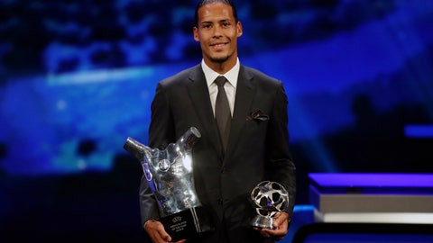 <p>               Dutch soccer player Virgil van Dijk of Liverpool holds the award of men's player of the year 2018/19 during the group stage draw at the Grimaldi Forum, in Monaco, Thursday, Aug. 29, 2019. (AP Photo/Daniel Cole)             </p>