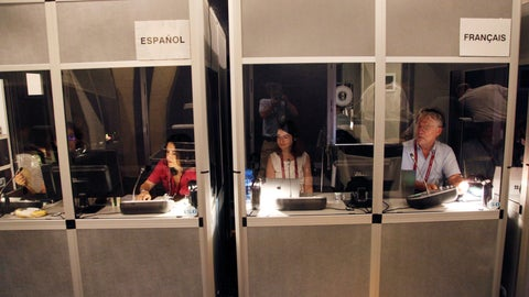 <p>               In this Tuesday, Aug. 20, 2019, photo, interpreters work in their booths during a Chef de Mission Seminar hosted by The Tokyo Organizing Committee of the Olympic and Paralympic Games, in Tokyo. Next year's Tokyo Olympics will be a fiesta for a team of about 100 interpreters. They will handle interpretation for more than 10,000 athletes representing more than 200 national Olympic committees. (AP Photo/Koji Sasahara)             </p>