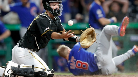 <p>               Chicago Cubs' Ian Happ (8) tumbles away after scoring from first on a triple by Tony Kemp as Pittsburgh Pirates catcher Jacob Stallings, left, tries to control the ball in the eighth inning of a baseball game, Friday, Aug. 16, 2019, in Pittsburgh. (AP Photo/Keith Srakocic)             </p>