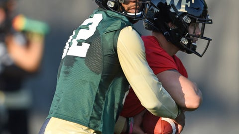<p>               Wake Forest quarterback Jamie Newman takes a snap during the first day of NCAA college football practice in Winston-Salem, N.C., Thursday, Aug. 1, 2019. (Walt Unks/Winston-Salem Journal via AP)             </p>