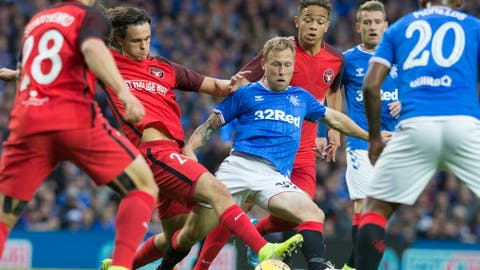 <p>               Rangers Scott Arfield, centre, in action against Danish team Midtjylland players during their Europa League Third Qualifying Round Second Leg soccer match at Ibrox Stadium in Glasgow, Scotland, Thursday Aug. 15, 2019. (Jeff Holmes/PA via AP)             </p>