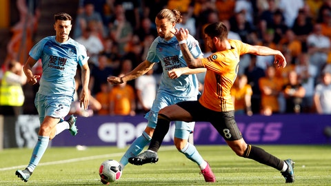 <p>               Burnley's Jay Rodriguez and Wolverhampton Wanderers's Ruben Neves, right, battle for the ball during the English Premier League soccer match Between Burnley and Wolverhampton Wanderers at Molineux, Wolverhampton, England, Sunday Aug. 25, 2019. (Darren Staples/PA via AP)             </p>