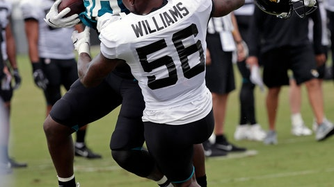 <p>               Jacksonville Jaguars linebacker Quincy Williams (56) loses his helmet as he tackles running back Ryquell Armstead, left, during an NFL football practice at the teams training facility, Thursday, Aug. 1, 2019, in Jacksonville, Fla. (AP Photo/John Raoux)             </p>