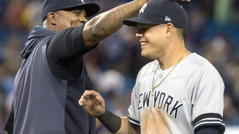 <p>               New York Yankees' Gio Urshela celebrates with C.C. Sabathia after the Yankees defeated the Toronto Blue Jays 12-6 in a baseball game Thursday, Aug. 8, 2019, in Toronto. (Fred Thornhill/The Canadian Press via AP)             </p>