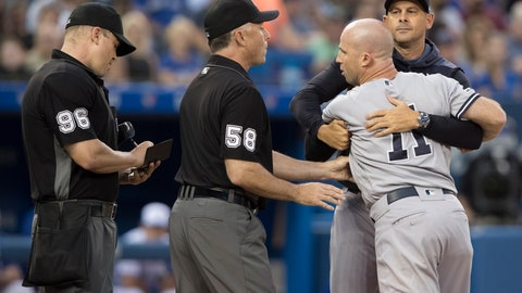 <p>               New York Yankees manager Aaron Boone, back right, holds Brett Gardner back from getting at home plate umpire Chris Segal, left, after a called third strike in the fourth inning of the team's baseball game against the Toronto Blue Jays on Friday, Aug. 9, 2019, in Toronto. First base umpire Dan Iassogna (58) is between Segal and Gardner. (Fred Thornhill/The Canadian Press via AP)             </p>