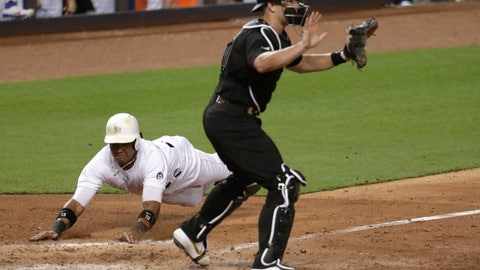 <p>               Miami Marlins' Starlin Castro, left, scores past Philadelphia Phillies catcher J.T. Realmuto on a double hit by Neil Walker during the fifth inning of a baseball game, Friday, Aug. 23, 2019, in Miami. (AP Photo/Lynne Sladky)             </p>