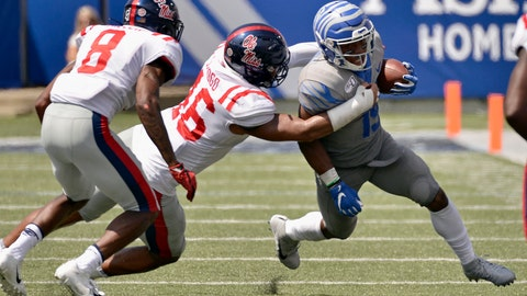 <p>               Memphis running back Kenneth Gainwell (19) carries the ball against Mississippi linebacker MoMo Sanogo (46) and defensive back C.J. Miller (8) in the second half of an NCAA college football game Saturday, Aug. 31, 2019, in Memphis, Tenn. (AP Photo/Brandon Dill)             </p>