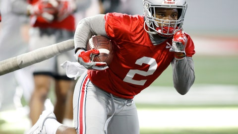 """<p>               FILE - In this Wednesday, March 6, 2019 file photo, Ohio State running back J.K. Dobbins runs through a drill during an NCAA college football practice in Columbus, Ohio. J.K. Dobbins wants to make up for his """"failure"""" last season. Despite rushing for over 1,000 yards, Dobbins calls 2018 a disappointment. He had a drop-off from his record-breaking freshman year and is determined to get back to that level and prove he's best running back in the nation.(AP Photo/Paul Vernon, File)             </p>"""