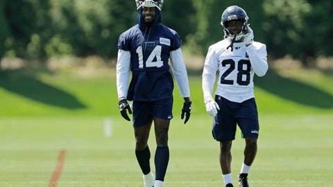 <p>               Seattle Seahawks wide receiver DK Metcalf (14) and cornerback Ugo Amadi (28) walk on the field following NFL football training camp, Monday, Aug. 5, 2019, in Renton, Wash. (AP Photo/Ted S. Warren)             </p>