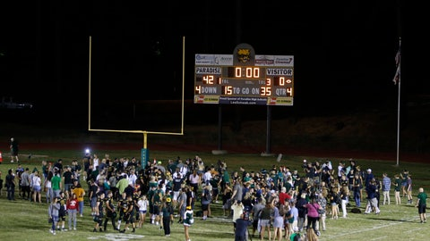 <p>               Players and fans of Paradise High School mill on the field after defeating Williams High School 42-0 in Paradise, Calif., Friday, Aug. 23, 2019. This was the first game for the school since a wildfire last year that killed dozens and destroyed nearly 19,000 buildings including the homes of most of the players. (AP Photo/Rich Pedroncelli)             </p>