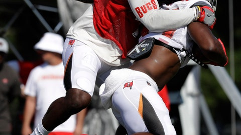 <p>               Tampa Bay Buccaneers linebacker Devin White, left, takes down running back Dare Ogunbowale (44) after a reception during an NFL football training camp practice Tuesday, July 30, 2019, in Tampa, Fla. (AP Photo/Chris O'Meara)             </p>