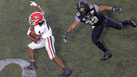 <p>               Georgia running back James Cook (4) gets past Vanderbilt safety Dashaun Jerkins (33) to score a touchdown on an 18-yard run in the first half of an NCAA college football game Saturday, Aug. 31, 2019, in Nashville, Tenn. (AP Photo/Mark Humphrey)             </p>