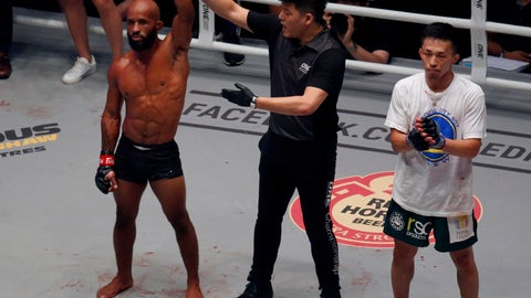 <p>               Demetrious Johnson, left, of the United States is proclaimed winner over Tatsumitsu Wada of Japan in their ONE Flyweight World Grand Prix semi-finals bout at the ONE Championship Mixed Martial Arts bout dubbed 'Dawn of Heroes' Friday, Aug. 2, 2019 at the Mall of Asia Arena in suburban Pasay city south of Manila, Philippines. Johnson defeated Wada a unanimous decision. (AP Photo/Bullit Marquez)             </p>