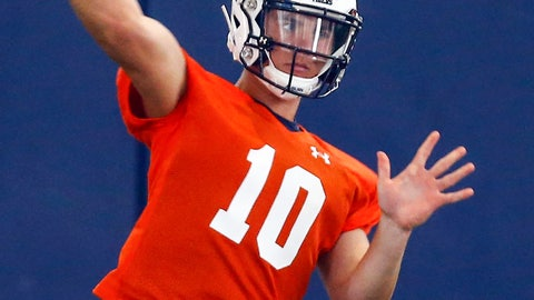 <p>               FILE - In this Aug. 2, 2019, file photo, Auburn quarterback Bo Nix throws a pass during NCAA college football practice in Auburn, Ala.  Freshman quarterback Bo Nix makes his college debut for No. 16 Auburn by matching up with No. 11 Oregon quarterback and potential first-round draft pick Justin Herbert in Arlington, Texas on Saturday, Aug. 31.  (AP Photo/Butch Dill, File)             </p>