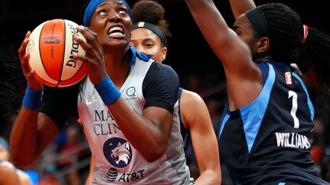 <p>               Minnesota Lynx center Sylvia Fowles goes up for a shot as Atlanta Dream center Elizabeth Williams (1) defends during the first half of a WNBA basketball game Tuesday, Aug. 6, 2019, in Atlanta. (AP Photo/John Bazemore)             </p>