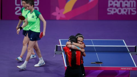 <p>               Adriana Diaz, right, and Melanie Diaz, of Puerto Rico, hug after defeating Bruna Takahasi and Jessica Yamada of Brazil in a women's doubles table tennis semifinal at the Pan American Games in Lima, Peru, Monday, Aug. 5, 2019. (AP Photo/Rebecca Blackwell)             </p>