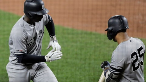 <p>               New York Yankees' Didi Gregorius, left, celebrates his solo home run off Baltimore Orioles starting pitcher Asher Wojciechowski with Gleyber Torres during the third inning of a baseball game Tuesday, Aug. 6, 2019, in Baltimore. (AP Photo/Julio Cortez)             </p>