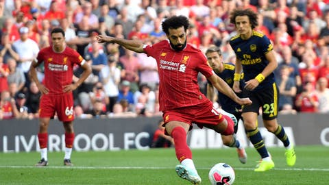 <p>               Liverpool's Mohamed Salah scores his side's second goal of the game from the penalty spot during the English Premier League soccer match against Arsenal at Anfield, Liverpool, England, Saturday Aug. 24, 2019. (Anthony Devlin/PA via AP)             </p>