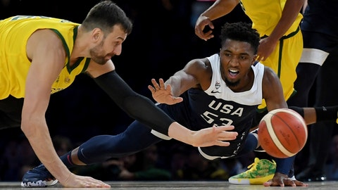<p>               Australia's Andrew Bogut, left and United States Donovan Mitchell, right compete for the ball during their exhibition basketball game in Melbourne, Saturday, Aug. 24, 2019. (AP Photo/Andy Brownbill)             </p>