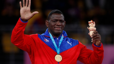 <p>               Cuba's Mijain Lopez waves from the podium after receiving the gold medal for men's 130kg Greco-Roman wrestling at the Pan American Games in Lima, Peru, Thursday, Aug. 8, 2019. (AP Photo/Rebecca Blackwell)             </p>