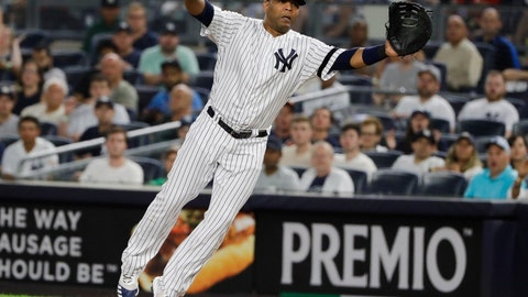 <p>               New York Yankees first baseman Edwin Encarnacion stretches to catch a throw from relief pitcher Tommy Kahnle during the seventh inning of a baseball game against the Boston Red Sox on Friday, Aug. 2, 2019, in New York. Jackie Bradley Jr. was out on the play. (AP Photo/Frank Franklin II)             </p>