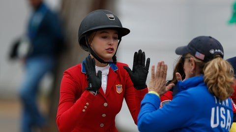 <p>               Eve Jobs of the U.S. is congratulated by a member of Team USA after competing on her horse Venue d'Fees des Hazalles in the first classification round of individual and team equestrian jumping at the Pan American Games in Lima, Peru, Tuesday, Aug. 6, 2019. (AP Photo/Rebecca Blackwell)             </p>