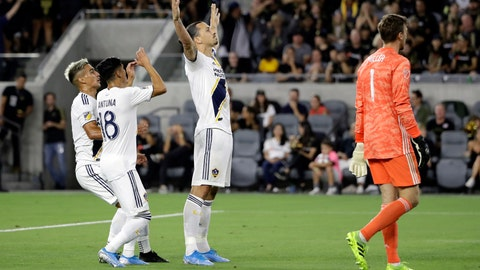 <p>               Los Angeles Galaxy's Zlatan Ibrahimovic, center, celebrates with teammates after scoring against Los Angeles FC during the first half of an MLS soccer match Sunday, Aug. 25, 2019, in Los Angeles. (AP Photo/Marcio Jose Sanchez)             </p>
